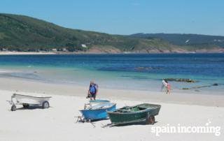 Summertime in the Camino: Pilgrim enjoying the Atlantic Ocean - Camino Fisterra Muxía
